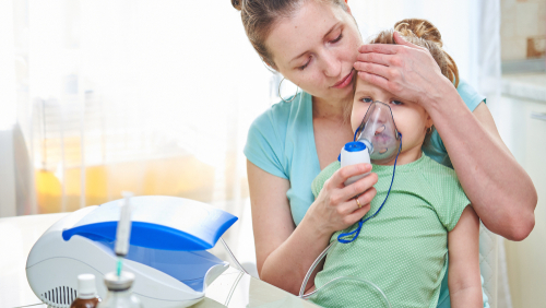 Mother and child with nebuliser